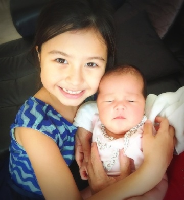 Adel's confinement month is about balancing time between her baby and her older daughter.