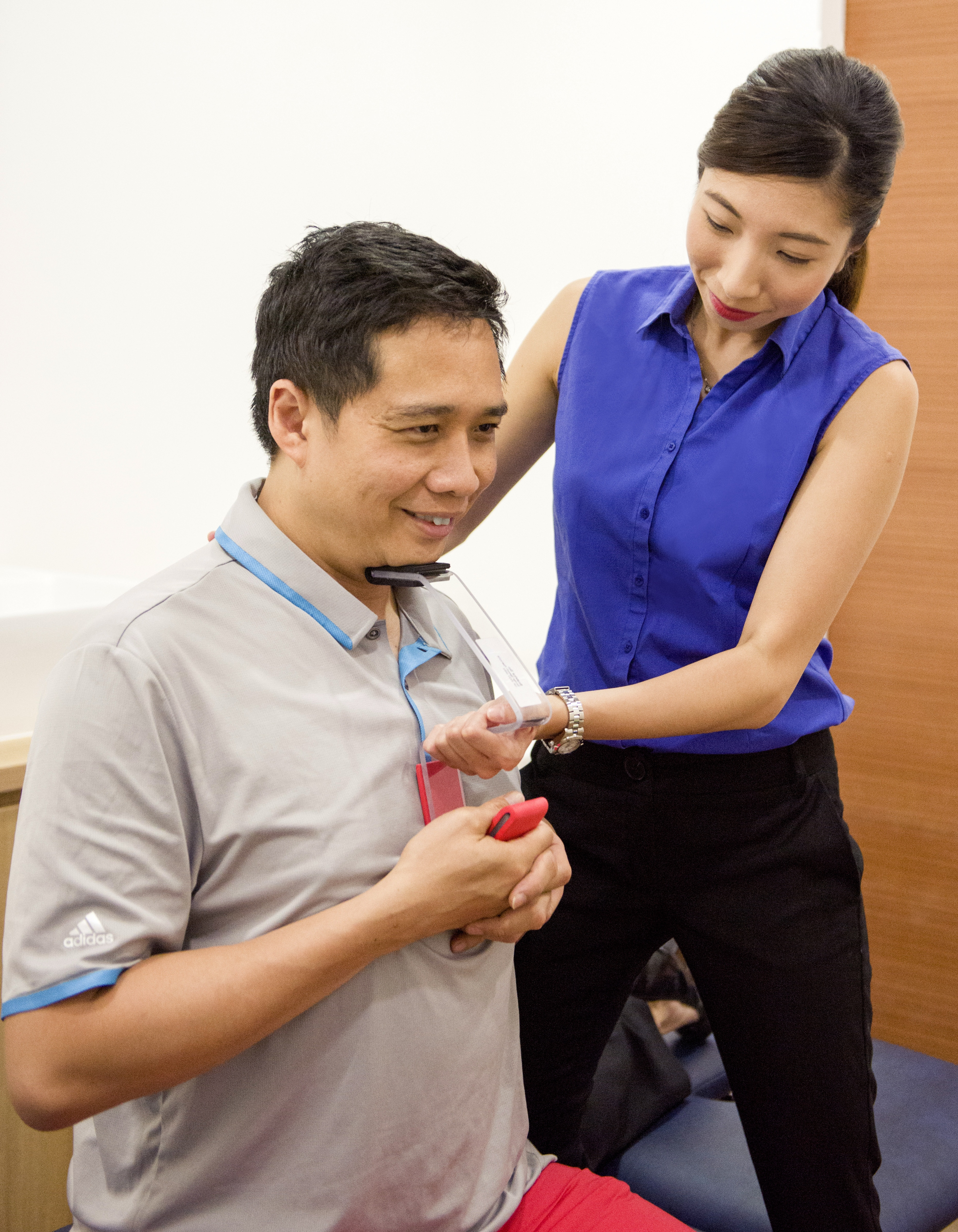 Speech therapist Beatrice showing a patient an isometric exercise.
