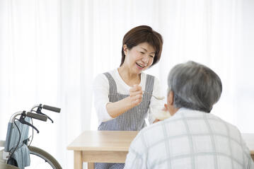 A Nurse Aide is professionally trained to feed the elderly who have chewing and swallowing difficulties.